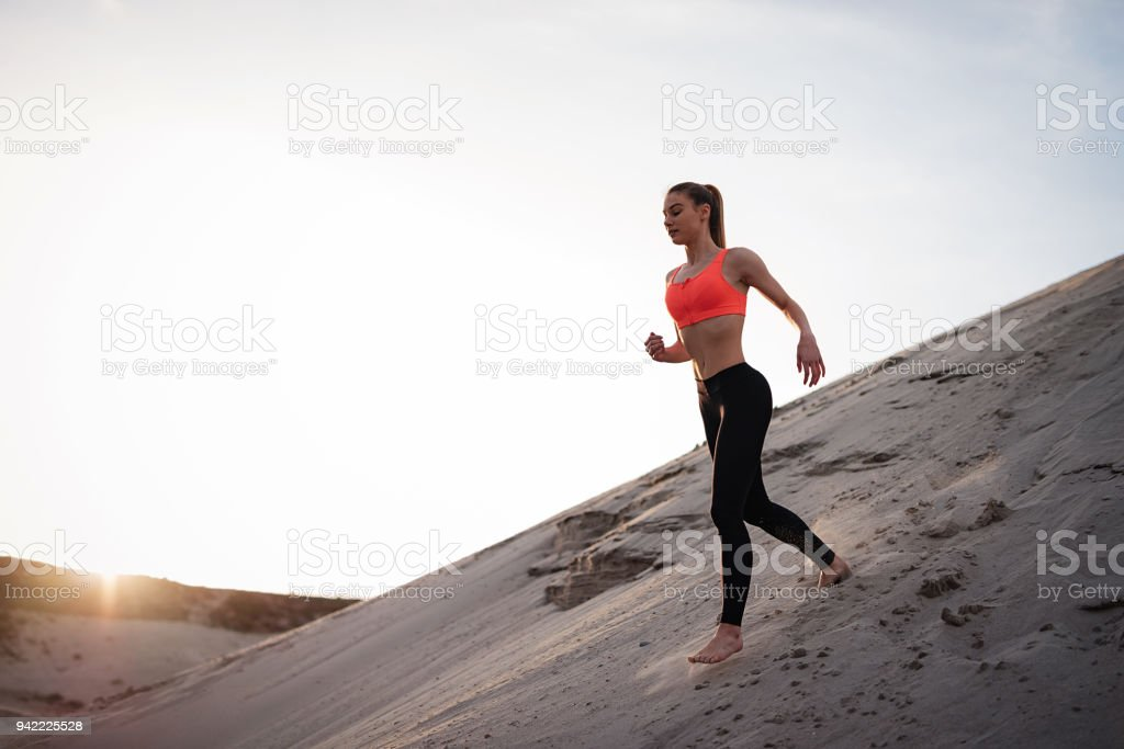 Very young determined woman or teenager loves sport and trains hard...