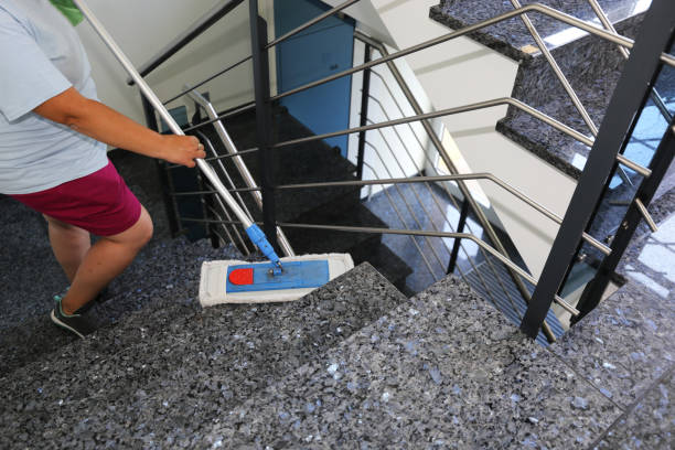 Professional staircase cleaning in a building stock photo
