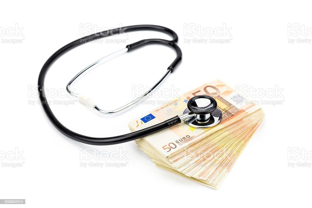 Professional stethoscope lying on stack of euro notes stock photo