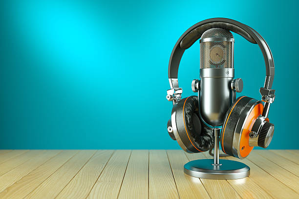 Professional studio microphone and headphones on wooden table Professional studio microphone and headphones on wooden table 3d render radio dj stock pictures, royalty-free photos & images