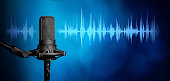 istock Professional studio microphone background, Podcast or recording studio banner 1310278461