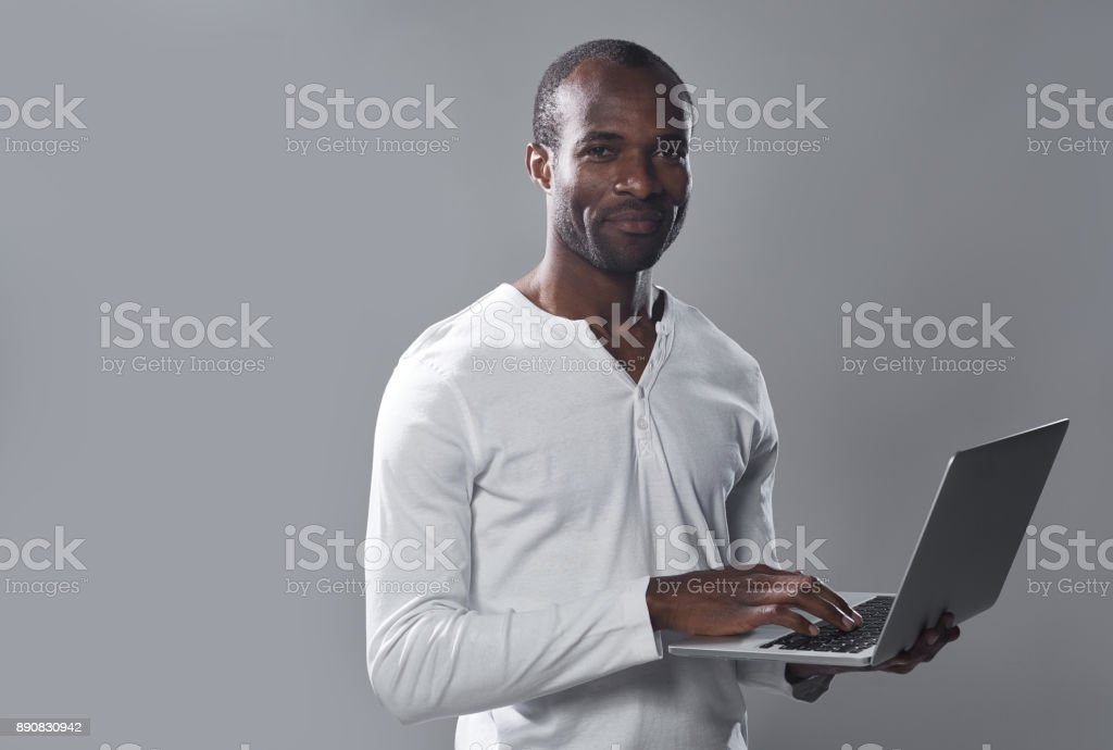 Professional stylish man is laboring on notebook stock photo