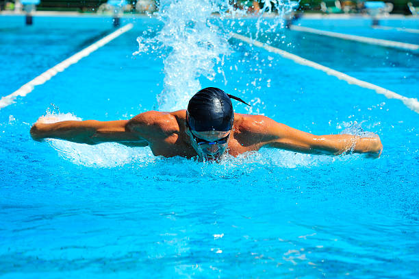 Professional swimmer in pool stock photo