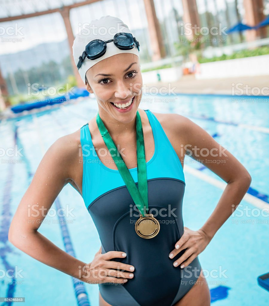 Professional swimmer winning a gold medal stock photo