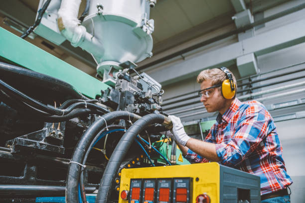 Professional technical worker man working with production line machine stock photo