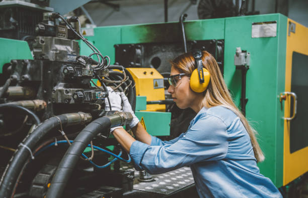 Professional technical worker woman working with production line machine stock photo