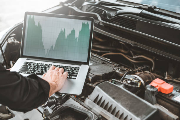 Professional Technician Hands of checking car engine repair service using laptop on car Professional Technician Hands of checking car engine repair service using laptop on car air filter stock pictures, royalty-free photos & images