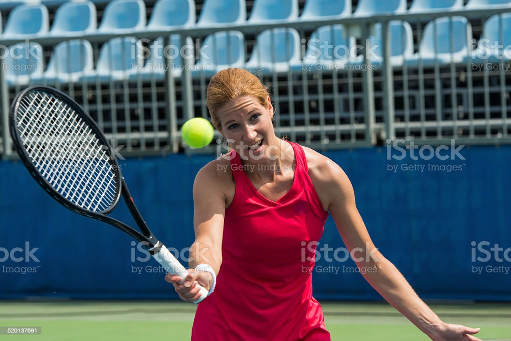 Professional Tennis Player Hit A Forehand stock photo