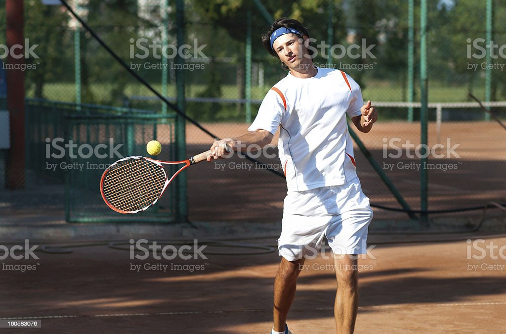 professional tennis player hitting a forehand stock photo