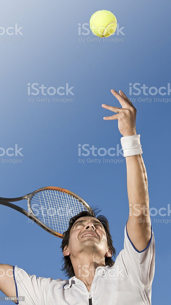 Professional tennis player hitting the ball royalty-free stock photo
