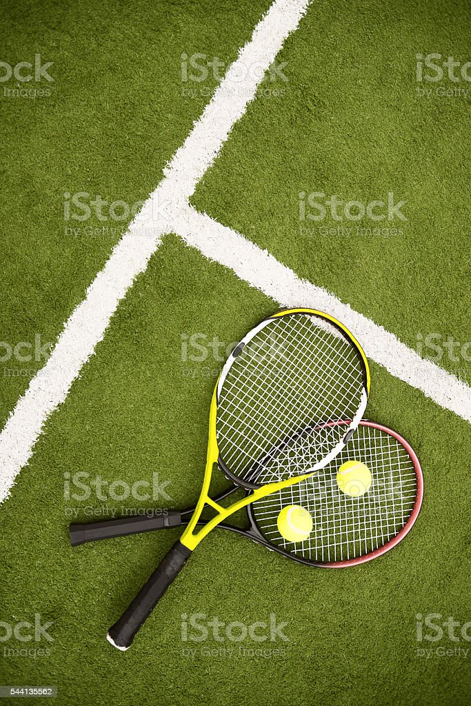 Professional tennis racquets on lawn stock photo