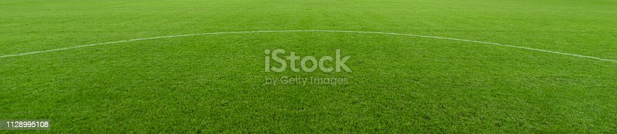 508552962 istock photo Professional turf, stands and lighting for evening outdoor football fields 1128995108