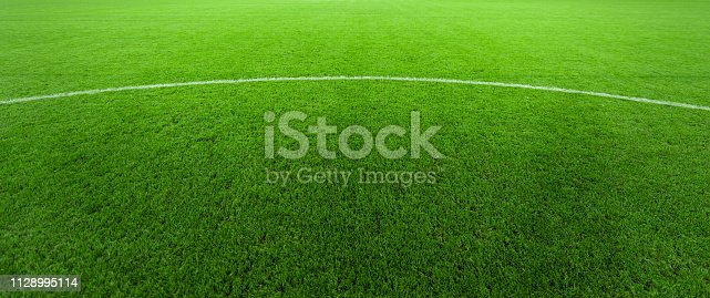 508552962 istock photo Professional turf, stands and lighting for evening outdoor football fields 1128995114