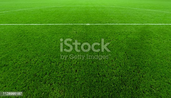 508552962 istock photo Professional turf, stands and lighting for evening outdoor football fields 1128995187