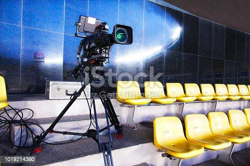 Professional TV camera filming event in a stadium