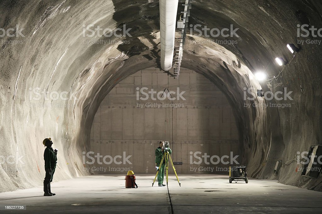 Professional underground workers stock photo