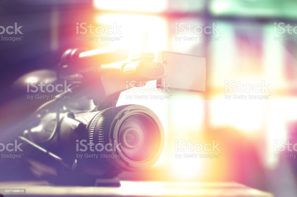 professional video camcorder in studio with blurred background for tv...