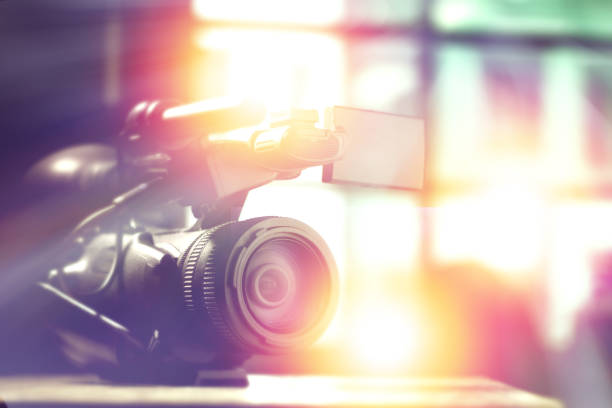 professional video camcorder in studio with blurred background for tv interview stock photo