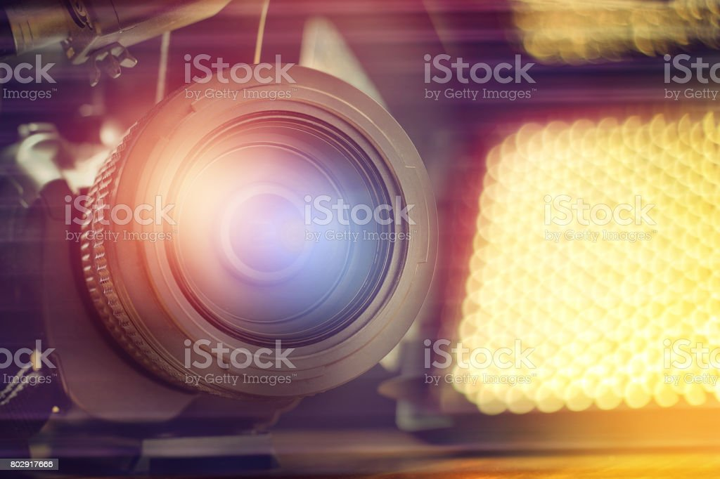 professional video camcorder in studio with blurred spot light background stock photo