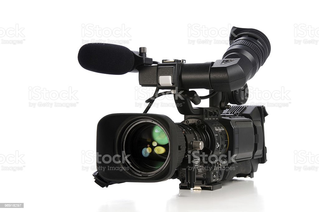 Professional video camera in black on white royalty-free stock photo