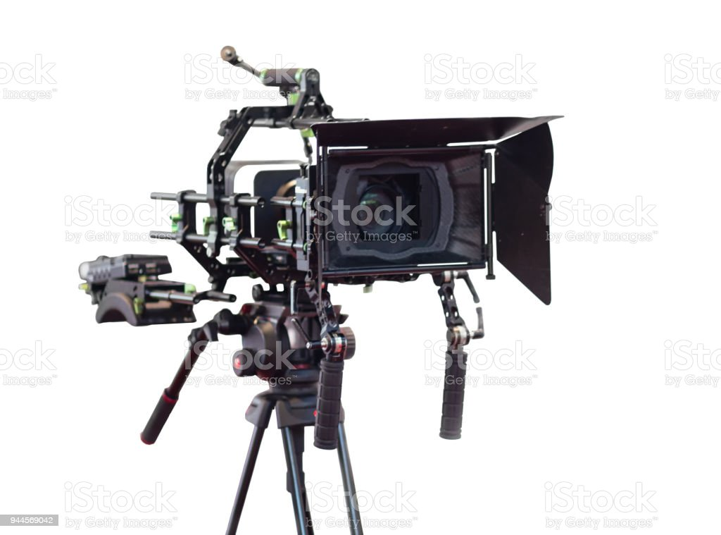 Professional video camera on a tripod isolated on white background stock photo