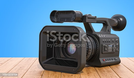Professional video camera on the wooden table. 3D rendering