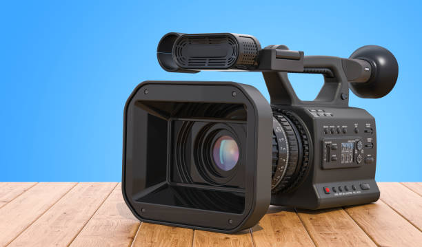 Professional video camera on the wooden table. 3D rendering stock photo