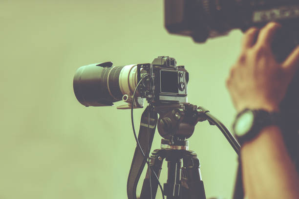 professional video camera with tripod stand by for shooting in studio production stock photo