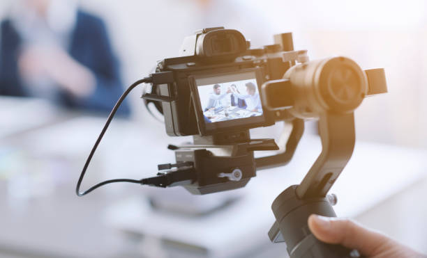 Professional videomaker shooting a video picture id1199399110?b=1&k=6&m=1199399110&s=612x612&w=0&h=9ykbtduvbb8yd uttbkozkbpip b803ubq51nhtnaqc=