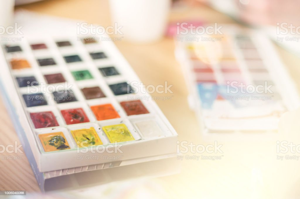 Professional watercolor aquarell paints in box with brushes , light toning, light toning stock photo