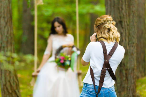 Professional wedding photographer taking close-up portraits of the bride stock photo