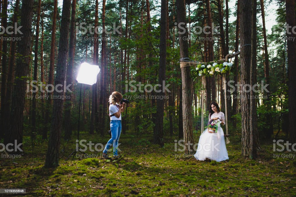 Professional wedding photographer using strobe and softbox to make pictures stock photo