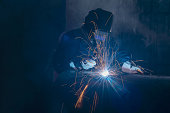 istock Professional welder and mask welding metal pipe. 1170817639
