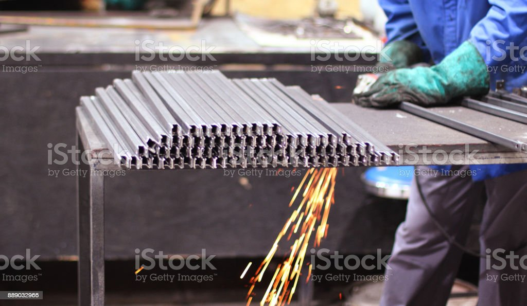 Professional welder in a factory welding stock photo