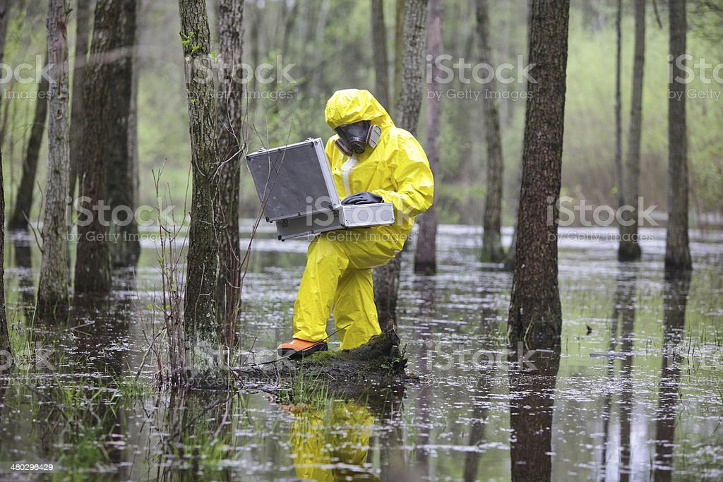 professional with mini lab in contaminated environment stock photo