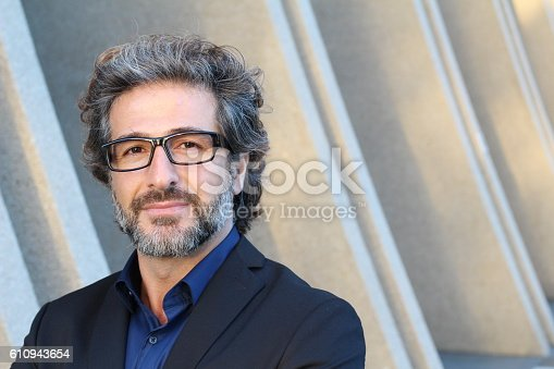 istock Professional with specs outside the office 610943654