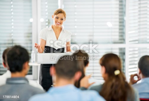 481711192 istock photo Professional woman giving speech to a crowd 175514924