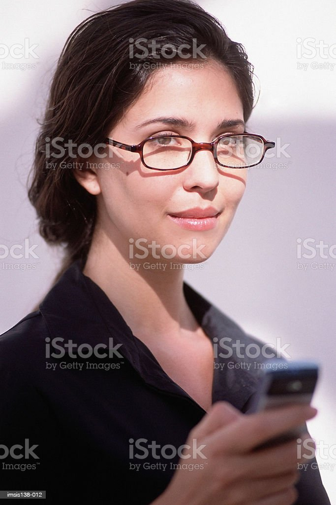 Professional woman with phone royalty-free stock photo