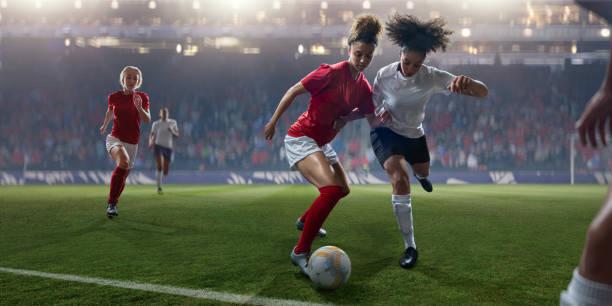 professional women soccer player dribbling ball past rival during match - soccer league stock pictures, royalty-free photos & images