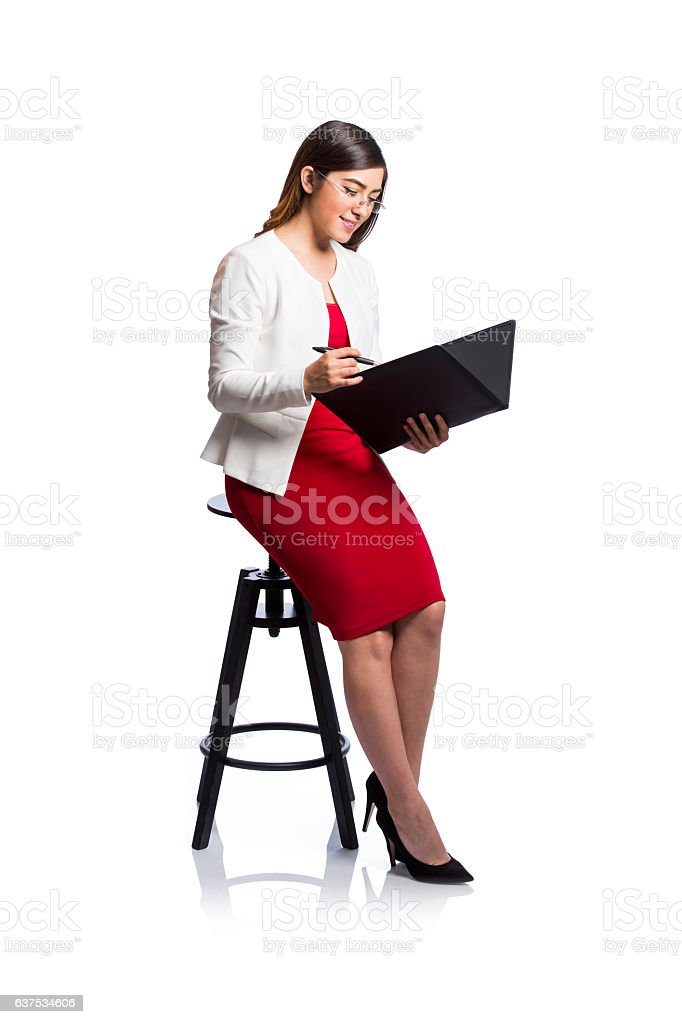 Professional worker holding and looking at document - foto de stock