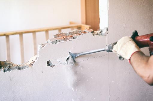 Breaking wall by hammer