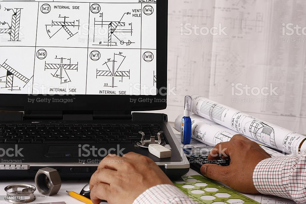 Professional working on welding designs on a laptop royalty-free stock photo