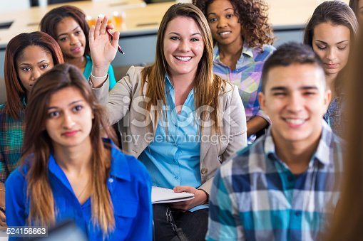 600055398 istock photo Professional young woman asking question during lecture or seminar 524156663