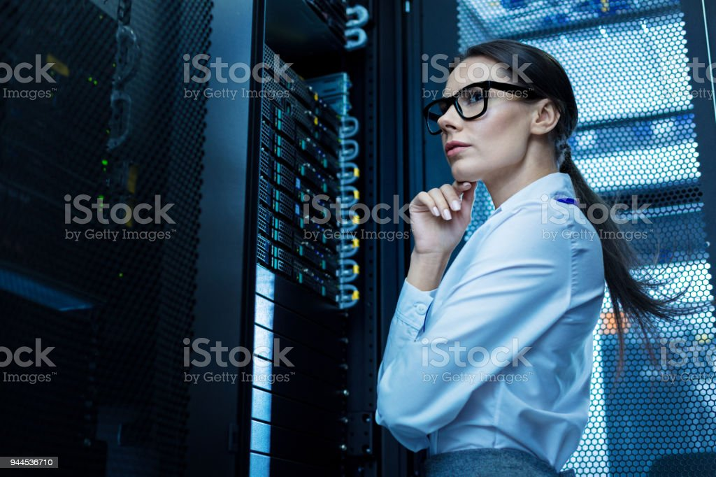 Professional young woman working in a data center stock photo