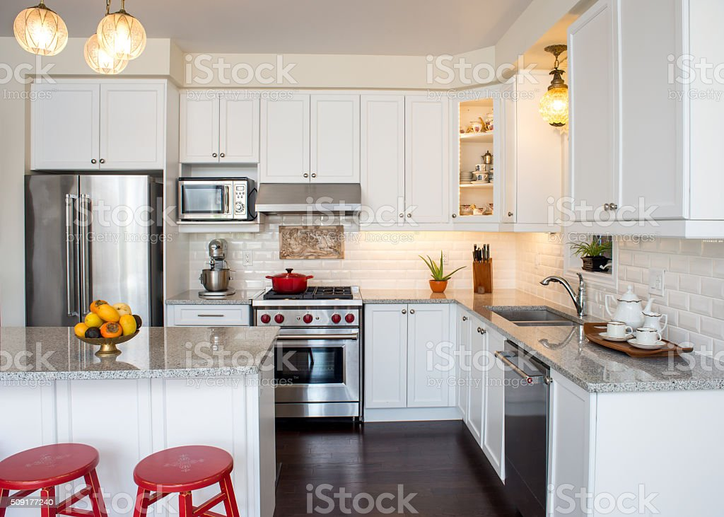 Professionally designed new white kitchen with touch of retro style stock photo