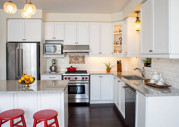 professionally designed new white kitchen with touch of retro style - domestic kitchen stock photos and pictures