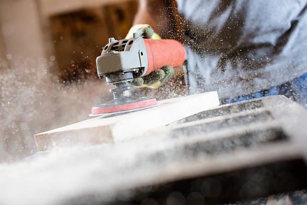 professionally dressed carpenter scraping board close up - waldhandwerk stock-fotos und bilder