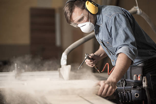 professionally dressed carpenter varnishing board - protective mask workwear stock pictures, royalty-free photos & images