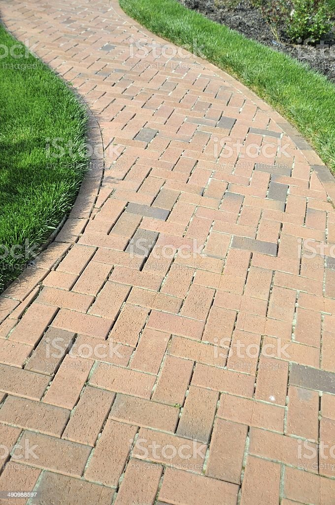 Professionally laid path of pavers in a garden stock photo