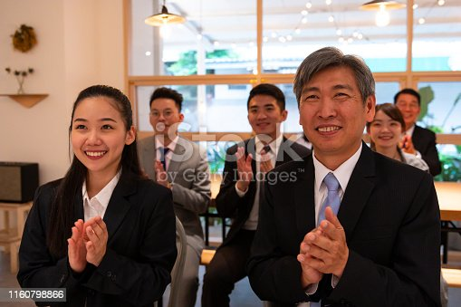istock Professionals applauding in conference meeting 1160798866